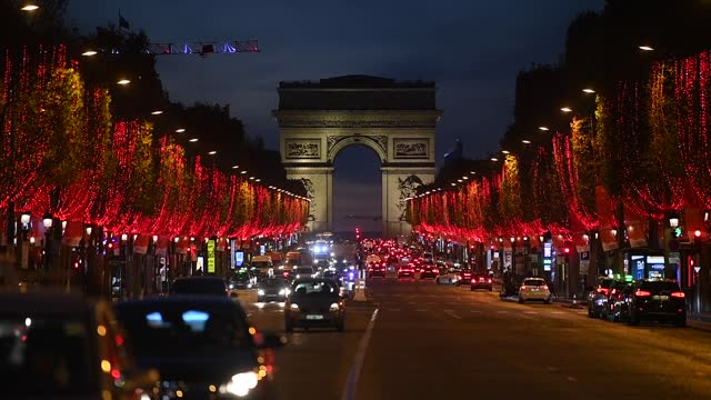 red lights decorate the trees to illuminate the champs-elysees avenue for christmas and new year celebrations near the arc de triomphe on november... - avenue stock videos & royalty-free footage