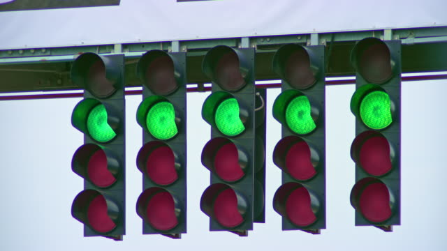 ld red lights followed by green on the start light at the formula race - repetition stock videos & royalty-free footage