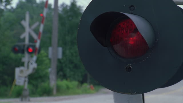 CU Red lights glowing on railroad crossing / Queens, New York, USA