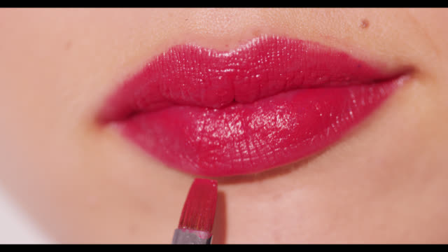 Red lips painted with lip brush