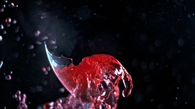 slo mo ld red liquid splashing around as the wine glass shatters - red wine stock videos & royalty-free footage