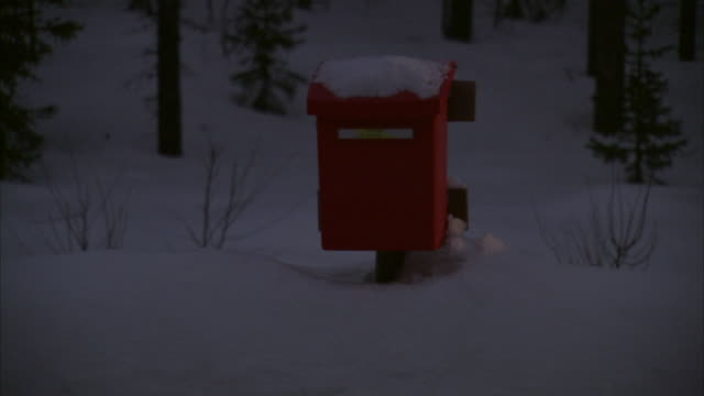 a red mailbox in the darkness by a road sweden. - headlight stock videos & royalty-free footage
