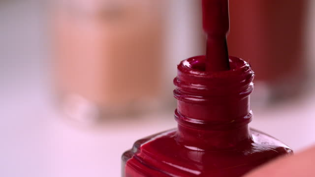 cu red nail polish bottle - femininity stock videos & royalty-free footage