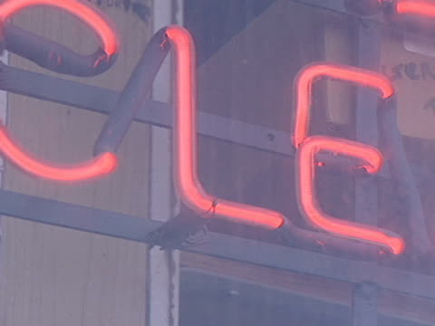 A red neon dry cleaning sign shows the way