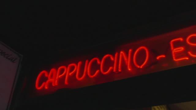 LA CU PAN Red neon sign reading Cappuccino - Espresso / New York, New York, USA