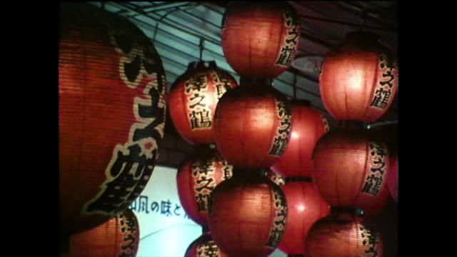 red paper lanterns swinging in breeze in hiroshima; 1975 - japanese script stock videos & royalty-free footage
