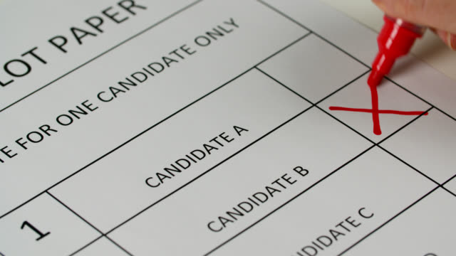 cu red pen marks a cross on ballot paper - politics stock videos & royalty-free footage