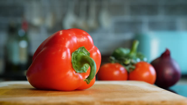 a red pepper is cut into four slices - pepper vegetable stock videos & royalty-free footage