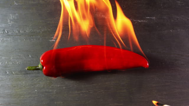 red pepper on fire - peperone video stock e b–roll