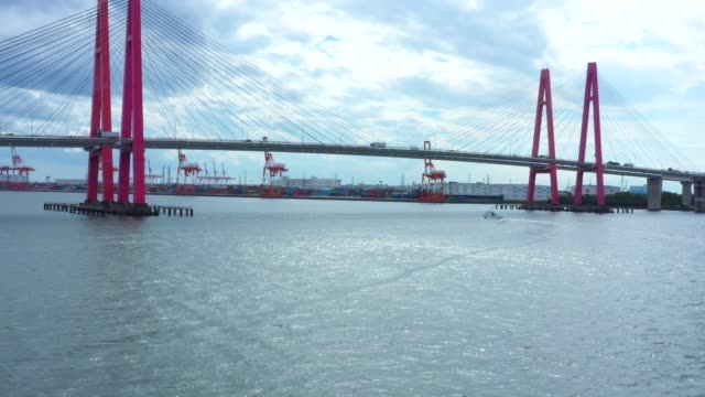 a red pillar suspension bridge - cable stayed bridge stock videos & royalty-free footage