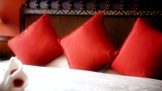 red pillows on a white bed - blanket background stock videos & royalty-free footage