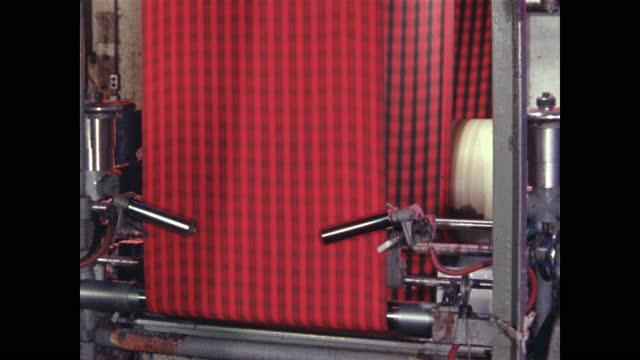 red plaid textile manufacturing - textilindustrie stock-videos und b-roll-filmmaterial