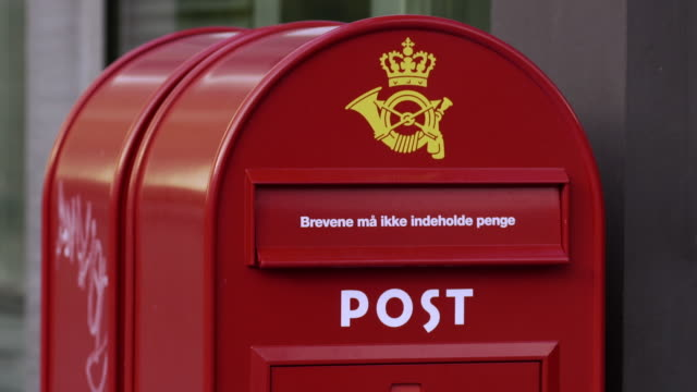 red post box in copenhagen - letterbox stock videos & royalty-free footage