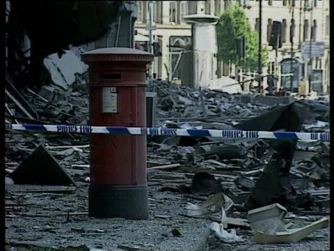 red post box unscathed from ira bomb exploding next to it manchester bombing 15 jun 96 - mailbox stock videos and b-roll footage