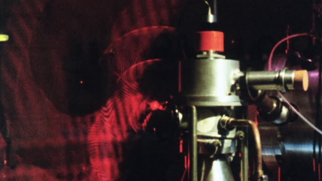 1981 zo red pulsing laser striking an instrument in a nuclear fusion research facility / united kingdom - nuclear fusion stock videos and b-roll footage