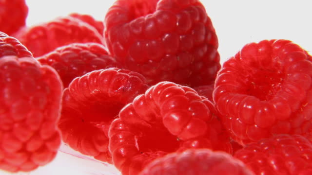 cu, pan, red raspberries - raspberry stock videos and b-roll footage