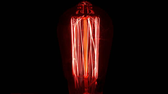 red retro bulb turning on - fade in video transition stock videos & royalty-free footage