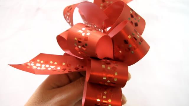 red ribbon - ribbon stock videos & royalty-free footage