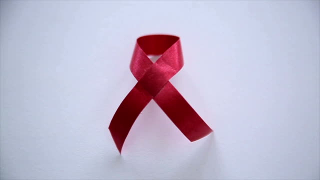 red ribbon,close up - aids stock videos & royalty-free footage