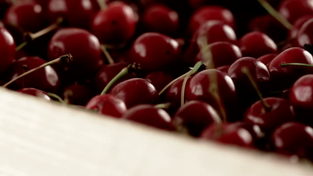 Red ripe cherry in box