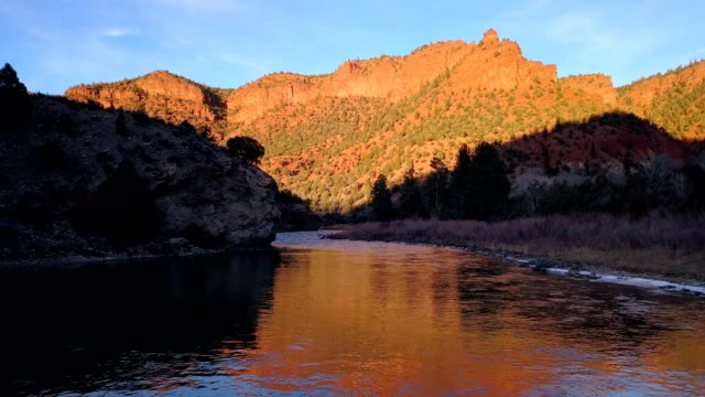 red rock river reflections - river colorado stock videos & royalty-free footage