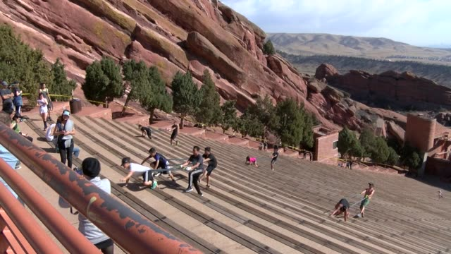 red rocks amphitheatre in denver is a tourist attraction nearly year round and also a great place to exercise on all the natural seating - red rocks stock videos & royalty-free footage