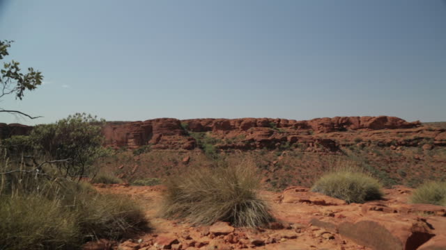 red rocks and grass at king's canyon, nt - northern territory australia stock videos & royalty-free footage