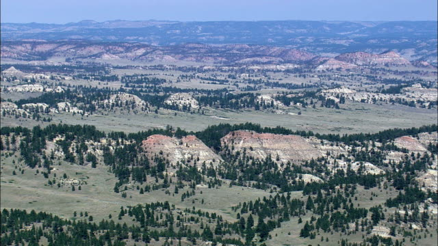 red rocks in crow indian reservation  - aerial view - montana, big horn county, united states - crow stock videos & royalty-free footage