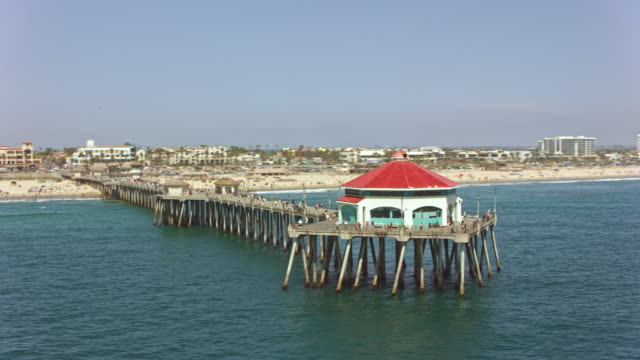aerial red roof diner on the pier of the huntington beach - huntington beach california stock videos and b-roll footage