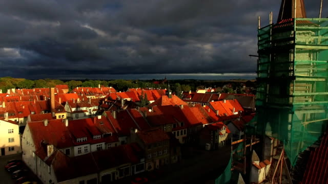 red roofs, green trees, cloudy sky - osteuropäische kultur stock-videos und b-roll-filmmaterial