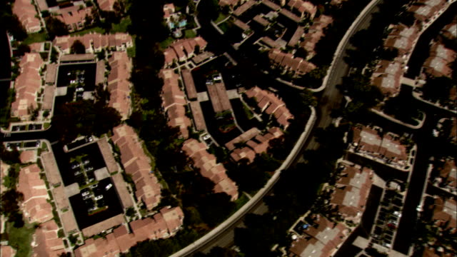 red roofs top houses in a development in a los angeles suburb. available in hd. - southern california stock videos and b-roll footage