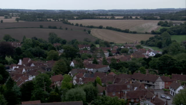 red rooftops of lavenham in the english countryside. available in hd. - lavenham stock-videos und b-roll-filmmaterial