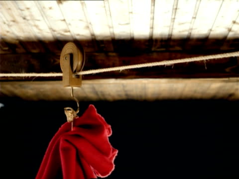 cu, pan, red sack hanging on pulley moving under ceiling, slovenia - pulley stock videos & royalty-free footage