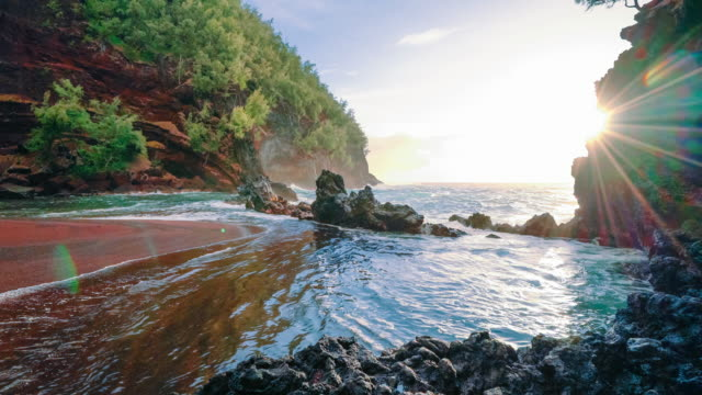 red sand beach sunrise sunrays flare - riva dell'acqua video stock e b–roll