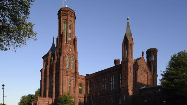 red sandstone makes us the smithsonian castle at the national mall. - smithsonian institution stock videos & royalty-free footage