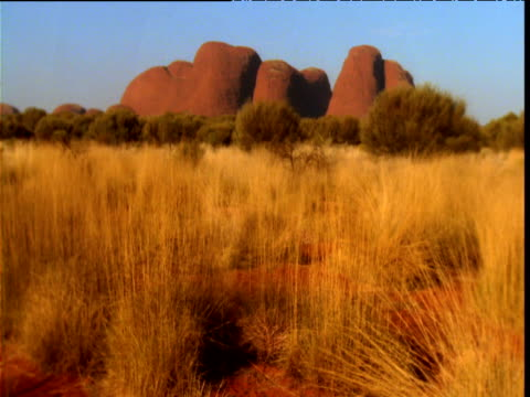 red sandstone of olgas stands over outback, northern territory, australia - sandstone stock videos & royalty-free footage