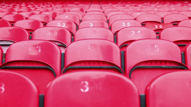 red seats in empty stadium - stand stock videos & royalty-free footage