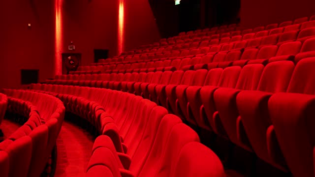 vídeos de stock e filmes b-roll de red seats in theather,horizontal slider move - film industry