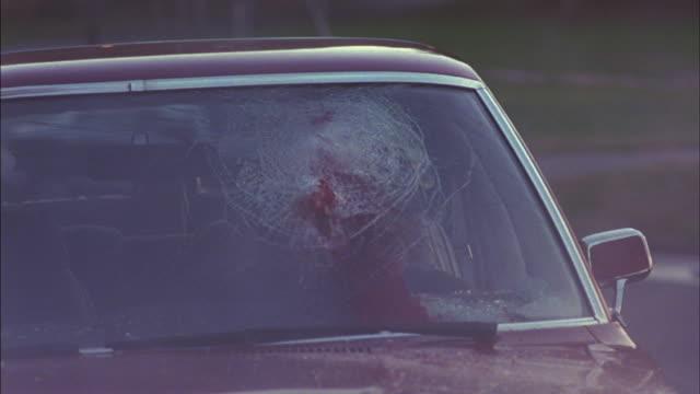 a red sedan with a crash dummy inside is pulled by a white cord until it crashes. - testdocka bildbanksvideor och videomaterial från bakom kulisserna
