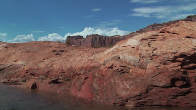 red sedimentary rock formations line a river in nevada. - sedimentary rock stock videos & royalty-free footage