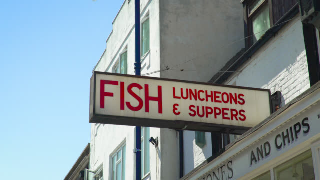 red sign above fish and chips shop, whitstable - shop sign stock videos & royalty-free footage