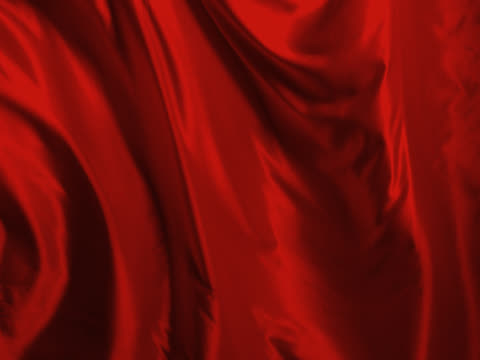 Red silk sheet blowing