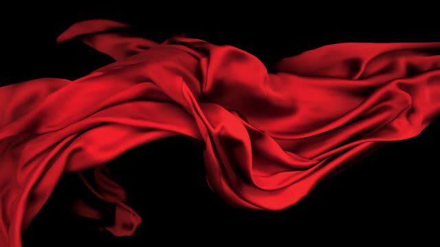 red silky fabric flowing and waving horizontally in super slow motion and close up, black background - 布点の映像素材/bロール