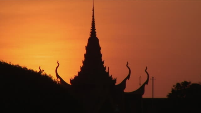 ms red sky over stupa / phnom penh, cambodia - phnom penh stock videos and b-roll footage