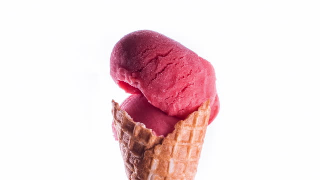 red sorbet ice-cream cone melting - ghiacciato video stock e b–roll
