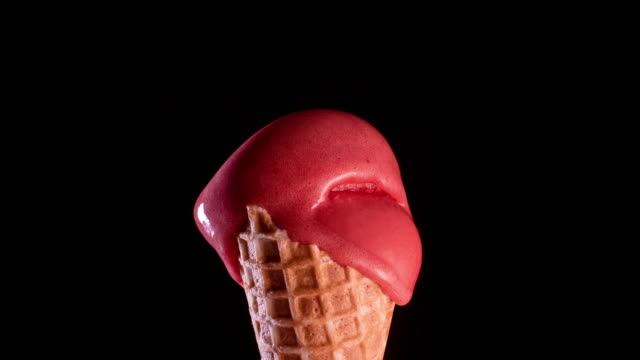 red sorbet ice-cream cone melting - waffled stock videos and b-roll footage