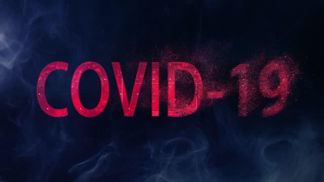 rött, gnistrande ord 'covid-19' på mörk bakgrund. försvinnande sjukdom metafor - maskinskriven text bildbanksvideor och videomaterial från bakom kulisserna