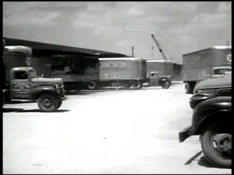 vídeos y material grabado en eventos de stock de red star' truck backing into spot, loading platform. trucks parking, moving. int workers w/ boxes in loading platform building, trucks lined up.... - usa