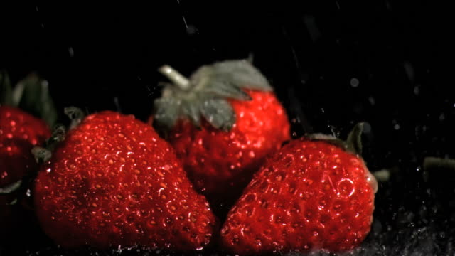 red strawberries in super slow motion being wet - five objects stock videos & royalty-free footage
