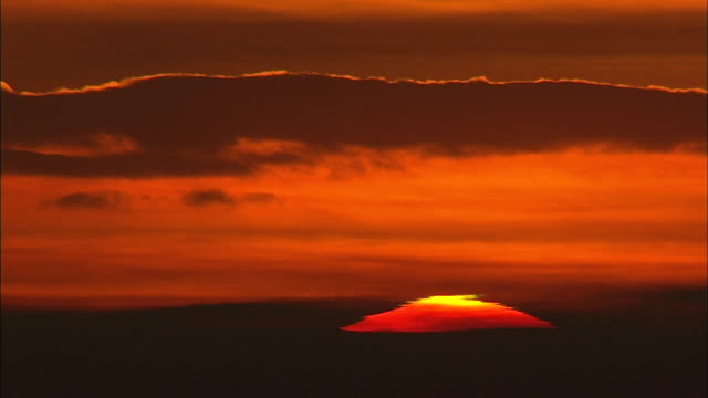 red sun rising in the morning sky - red cloud sky stock videos & royalty-free footage